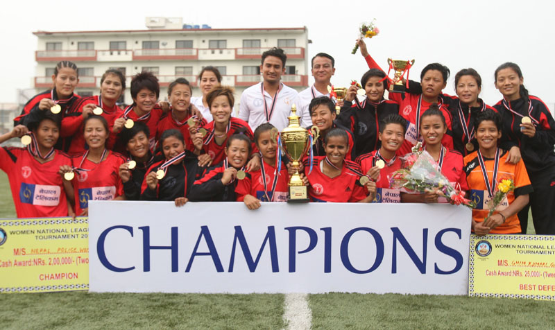 Nepal Police Club players and officials celebrate after winning the Women's National Football League Tournament in Lalitpur on Monday, May 2, 2016. Photo: Udipt Singh Chhetry/THT