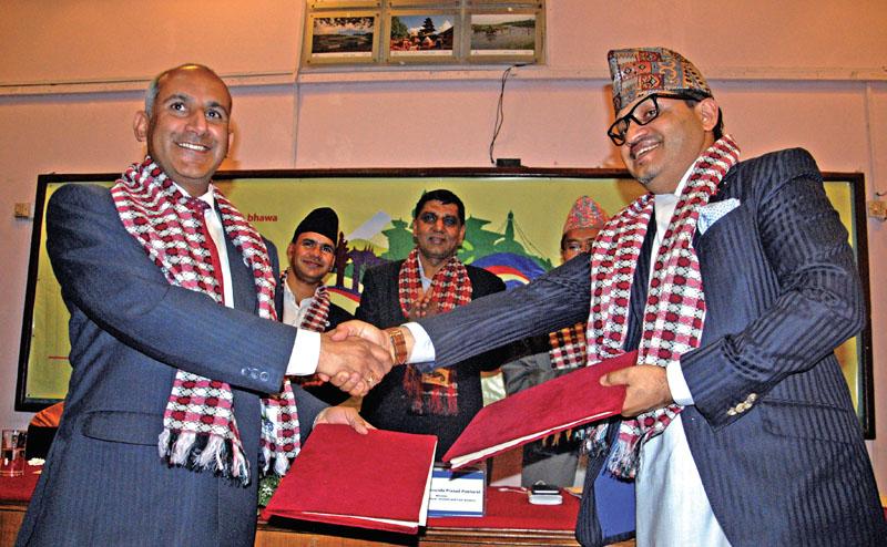Nepal Tourism Board CEO Deepak Raj Joshi (left) exchanging MoU with Bhaban Bhatta, Vice President of NRNA, in Kathmandu, on Tuesday, May 17, 2016. Photo: Balkrishna Thapa Chhetri/THT