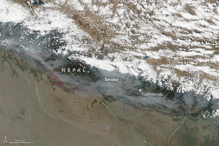 FILE: On April 11, 2016, the Visible Infrared Imaging Radiometer Suite (VIIRS) on the Suomi NPP satellite acquired this image of fires burning across Nepal. Red outlines indicate hot spots where VIIRS detected warm surface temperatures associated with the fires. Plumes of smoke dispersed across the country. Image: NASAn
