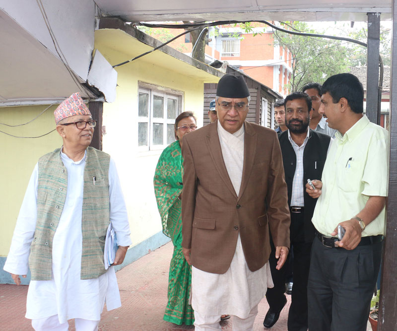 Nepali Congress President Sher Bahadur Deuba emerges from the meeting of senior leaders of major political parties in the Capital on Friday, May 27, 2016. Photo: RSS n
