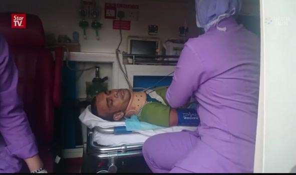This video grab shows injured Nepali migrant worker. Credit: The Star Online