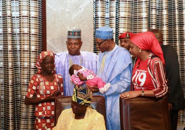 Amina Ali Darsha Nkeki, a Nigerian schoolgirl rescued after over two years of captivity with Boko Haram militants, presents her child to President Muhammadu Buhari in Abuja, Nigeria May 19, 2016. REUTERS/Afolabi Sotunde