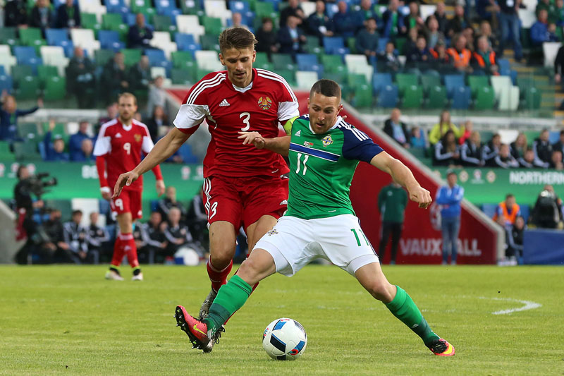 Northern Ireland's Conor Washington (right) and Belarus' Aleksandr Martynovich during the international friendly football match Northern Ireland against Belarus at Windsor Park, Belfast, Northern Ireland, on Friday, May 27, 2016. Photo: Niall Carson/PA via AP