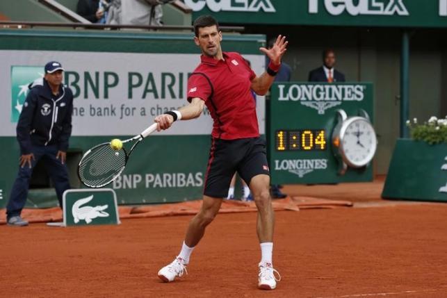 Tennis - French Open - Roland Garros - Novak Djokovic of Serbia vs Yen-Hsun Lu of Taiwan - Paris, France - 24/05/16. Novak Djokovic in action. REUTERS/Benoit Tessier