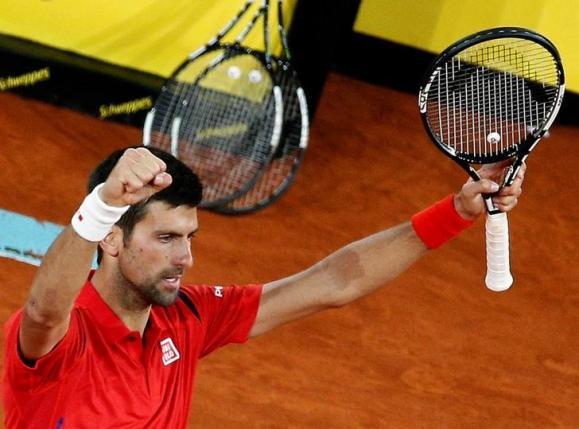 Tennis - Madrid Open - Men's Semi-finals - Novak Djokovic of Serbia v Kei Nishikori of Japan - Madrid, Spain - 7/5/16 Djokovic celebrates winning the match. REUTERS/Andrea Comas