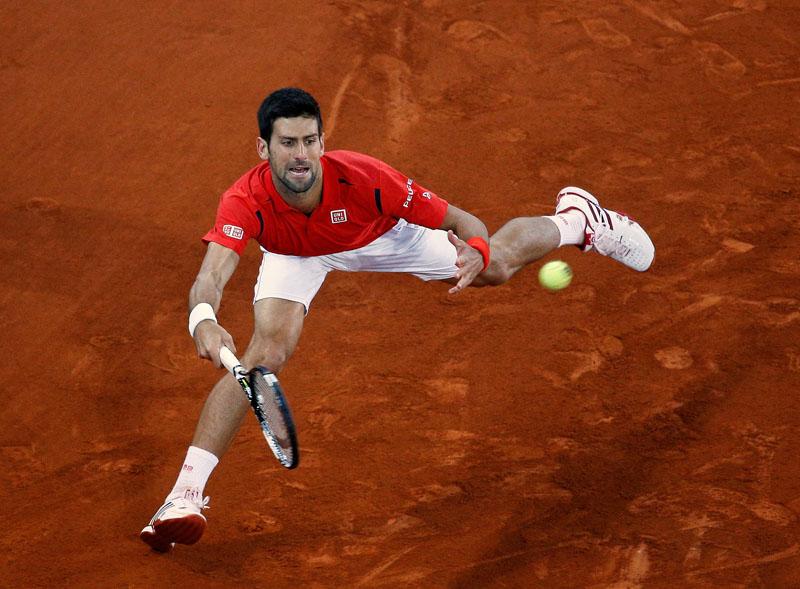 Novak Djokovic of Serbia returns to Kei Nishikori of Japan during their Madrid Open semi-final match on Saturday. Photo: Andrea Comas/Reuters