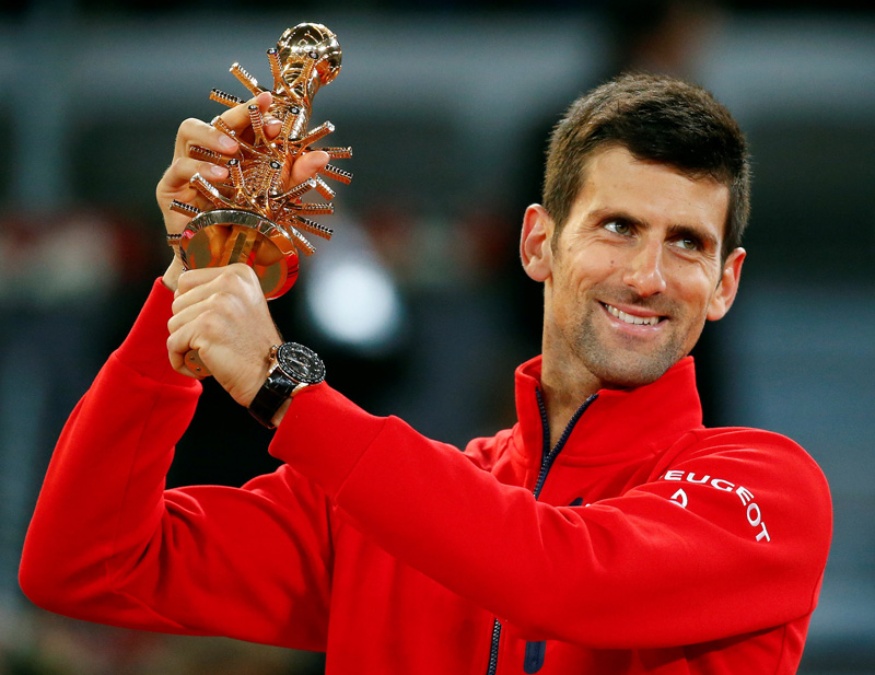 Djokovic holds up the trophy after defeating arch rival Andy Murray of Britian at Madrid Open Tennis Final in Madrid on Sunday, May 8, 2016. Photo: Reuters