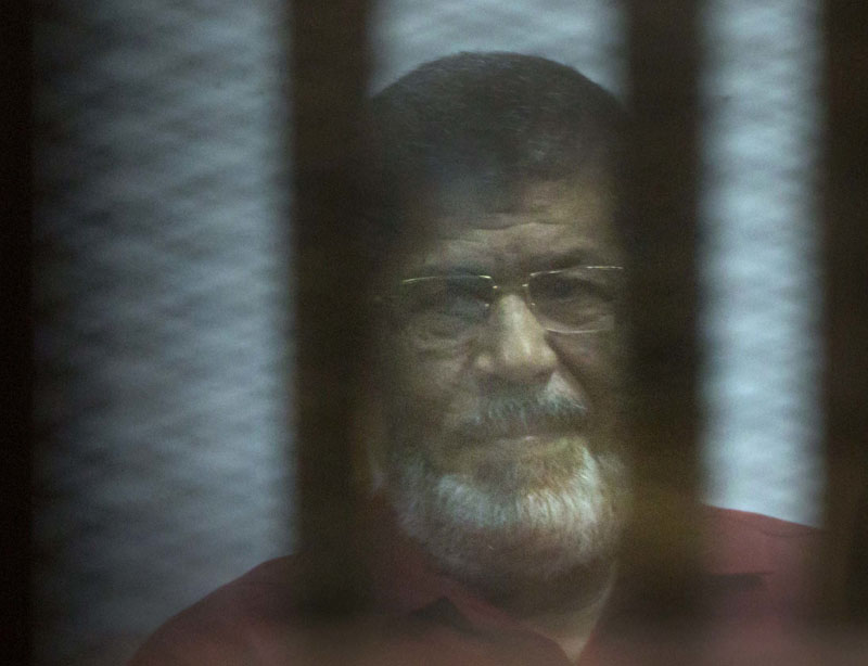 Ousted Egyptian President Mohammed Morsi, wearing a red jumpsuit that designates he has been sentenced to death, sits inside a defendants cage in a makeshift courtroom at the national police academy, in an eastern suburb of Cairo, Egypt, on Saturday, April 23, 2016.Photo: Amr Nabil/AP