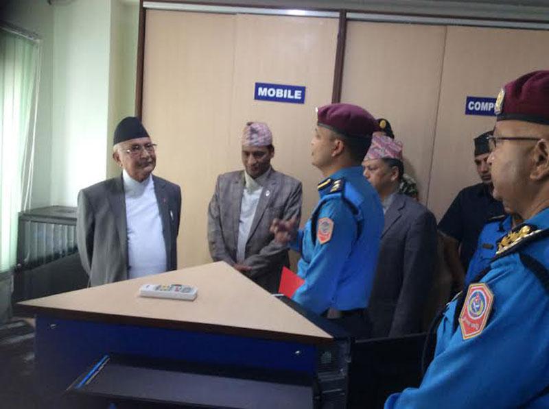 A senior police officer talks to Prime Minister KP Sharma Oli at the Nepal Police Headquarters at Naxal on Saturday, May 07, 2016. Photo: PM's Secretariat
