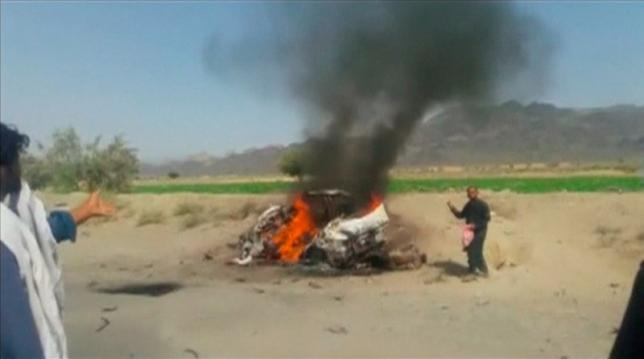A car is seen on fire at the site of a drone strike believed to have killed Afghan Taliban leader Mullah Akhtar in southwest Pakistan in this still image taken from video, May 21, 2016. REUTERS/via REUTERS TV