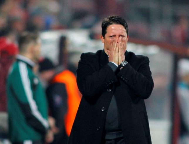 CFR Cluj's head coach Paulo Sergio reacts during their Europa League soccer match against Inter Milan in Cluj-Napoca, 426 km (265 miles) northwest of Bucharest February 21, 2013.  REUTERS/Bogdan Cristel