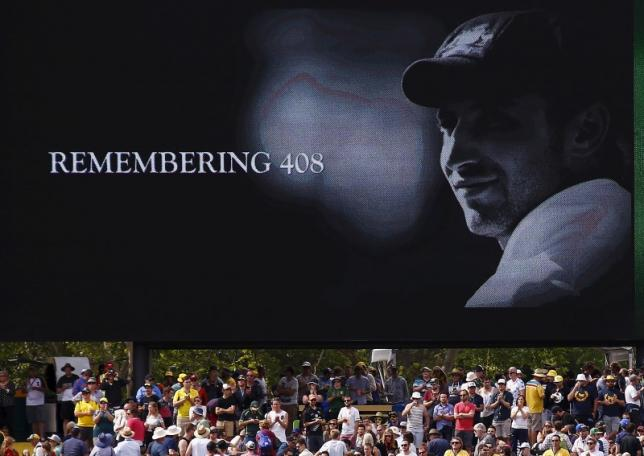 A tribute to former Australian cricketer Phillip Hughes, who was the 408th player for Australia, is displayed on a screen during the first day of the third cricket test match between Australia and New Zealand at the Adelaide Oval in South Australia, November 27, 2015. REUTERS/David Gray