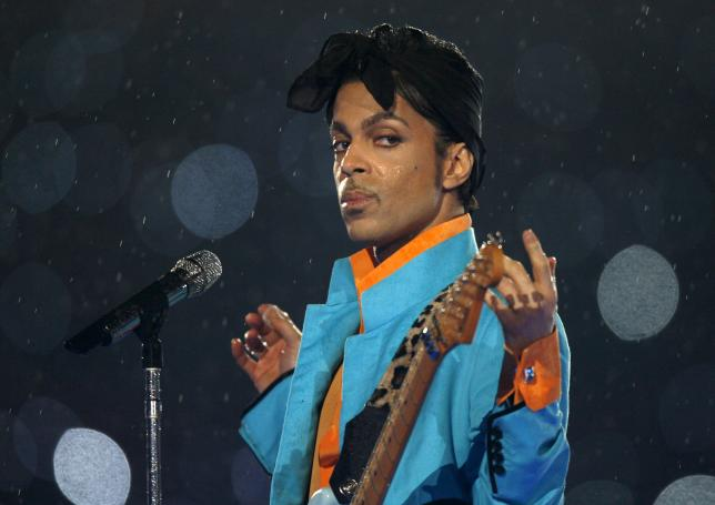 Prince performs during the halftime show of the NFL's Super Bowl XLI football game between the Chicago Bears and the Indianapolis Colts in Miami, Florida, U.S. February 4, 2007. REUTERS/Mike Blake/Files