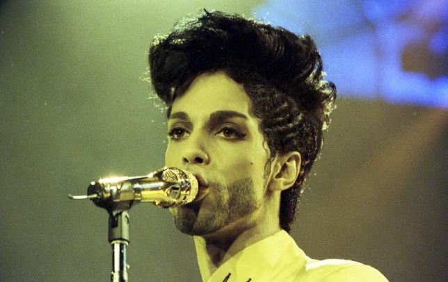 Prince performs during his 'Diamonds and Pearls Tour' at the Earl's Court Arena in London, Britain, June 15, 1992.   REUTERS/Dylan Martinez/Files