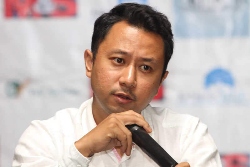 Proprietor of Indoor Sports Arena Nawang Nima Lama speaks during a press conference of the first nAmateur Archery Tournament in Kathmandu on Thursday. Photo: THT