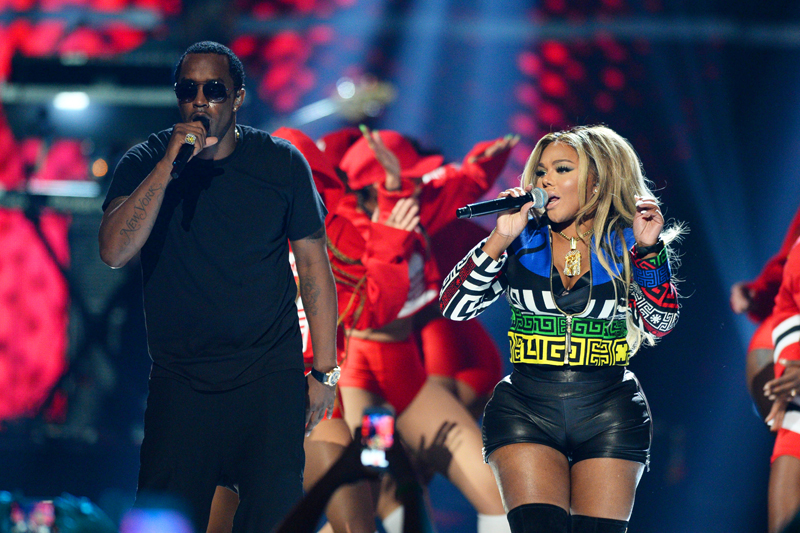 FILE - In this September 19, 2015, file photo, Puff Daddy, left, performs with Lil Kim at the 2015 iHeartRadio Music Festival in Las Vegas. Photo: AP