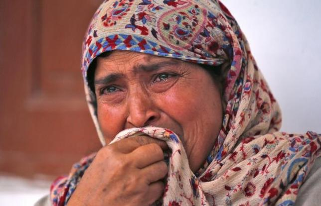 Rafiqa, mother of Shaista Hameed who was killed by a stray bullet during an encounter, cries during an interview with Reuters in Lalhar, south of Srinagar May 16, 2016. REUTERS/Danish Ismail