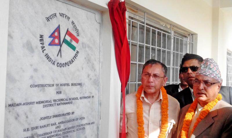 Indian Ambassador Ranjit Rae and Pradip Nepal, chairman of Madan Ashrit Foundation, jointly inaugurating the newly constructed hostel building for Madan Ashrit Memorial Technical School at Gothatar, Kathmandu, on Saturday, May 14, 2016. Photo: THT