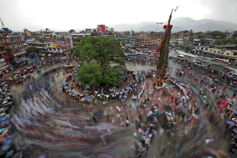This photograph shot with a slow camera shutter speed shows the movement of devotees as they pull the chariot of the Rato Machhindranath chariot festival in Lalitpur, on Tuesday, May 17, 2016. Photo: AP