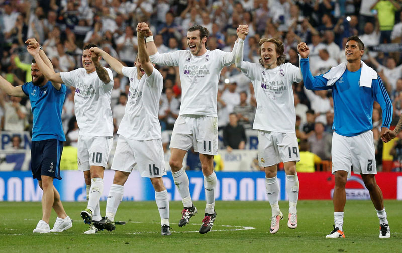 Real Madrid players celebrate after beating Manchester City in their UEFA Champions League semi-final second leg match in Madrid on Wednesday, May 4, 2016. Photo: Reuters