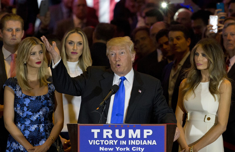 Republican presidential candidate Donald Trump is joined by his wife Melania (right) daughter Ivanka (left) and son Eric (background left) as he speaks during a primary night news conference, on Tuesday, May 3, 2016, in New York. Photo: Mary Altaffer/AP