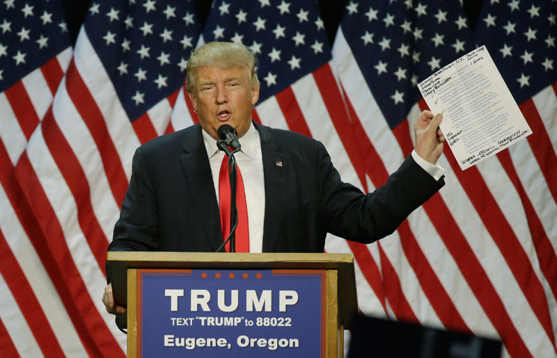 Republican presidential candidate Donald Trump holds up a sheet of talking points and notes as he speaks during a rally in Eugene, Oregon, on Friday, May 6, 2016. Photo: Ted S. Warren/AP