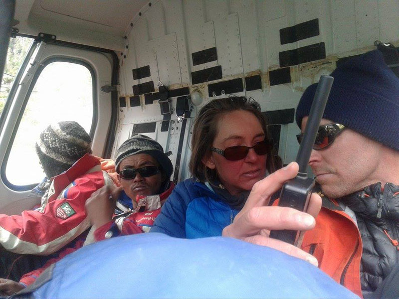 (From right) German couple Tobias Groenen and Gudrun Ziermann, along with two Nepali support staff inside a chopper before being airlifted to Kathmandu after they were rescued along with 16 others, from Saribung Peak region, on Saturday. Photo Courtesy: Manang CDO Bhimkanta Sharma