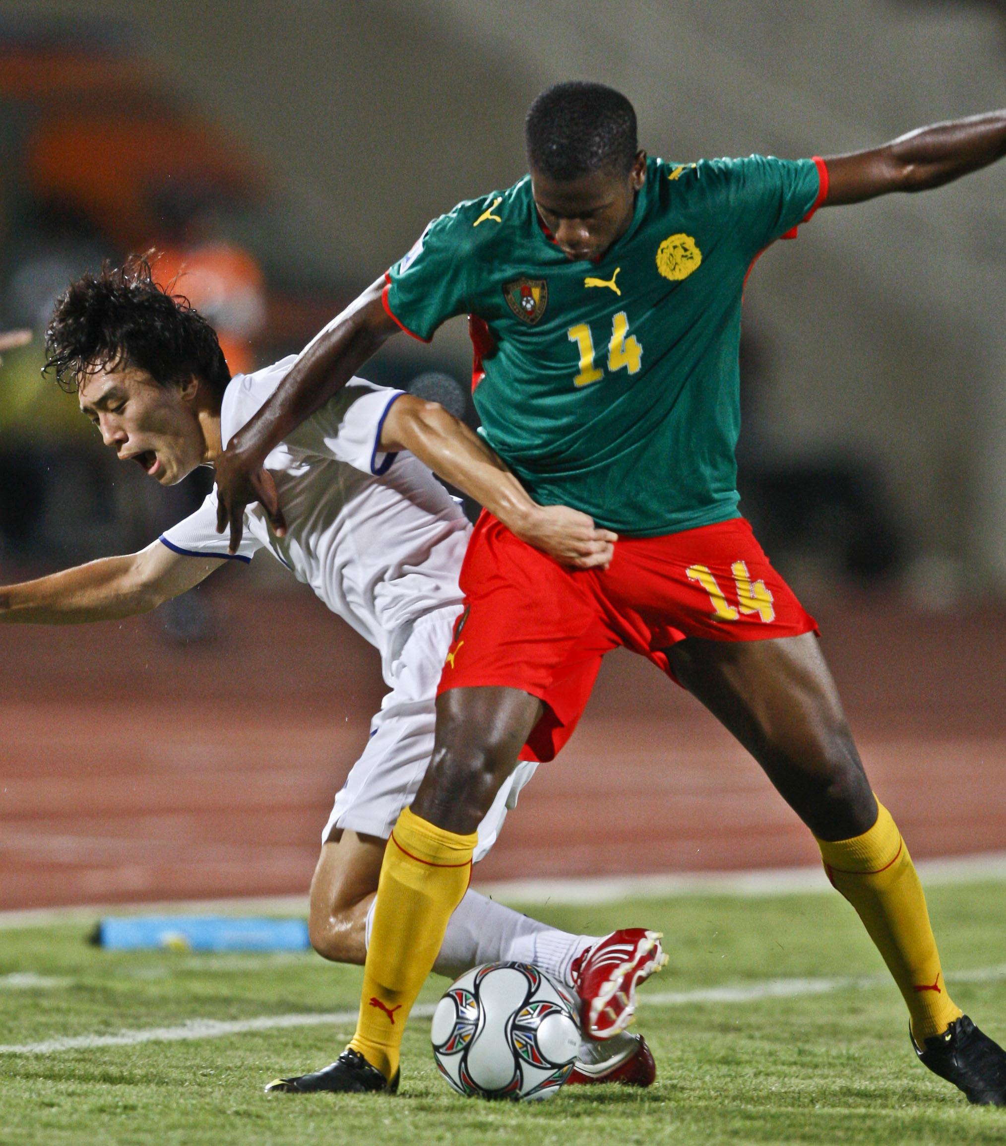 FILE - Cameroon's Patrick Ekeng (right) challenges Korea's Oh Jae Suk during their U-20 World Cup group C football match at the Suez Mubarak Stadium in Suez, Egypt,on Saturday, September 26, 2009. Photo: Nasser Nasser/AP