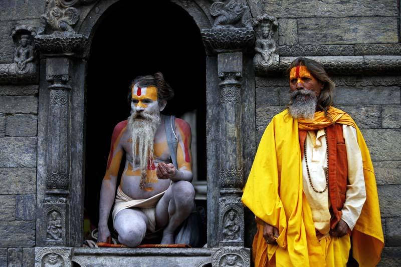 Sadhus take shelter at a shrine on a rainy morning on the premises of the Pashupatinath Temple, a UNESCO world heritage site, in Kathmandu, on Thursday, May 12, 2016. Photo: Skanda Gautam/ THT