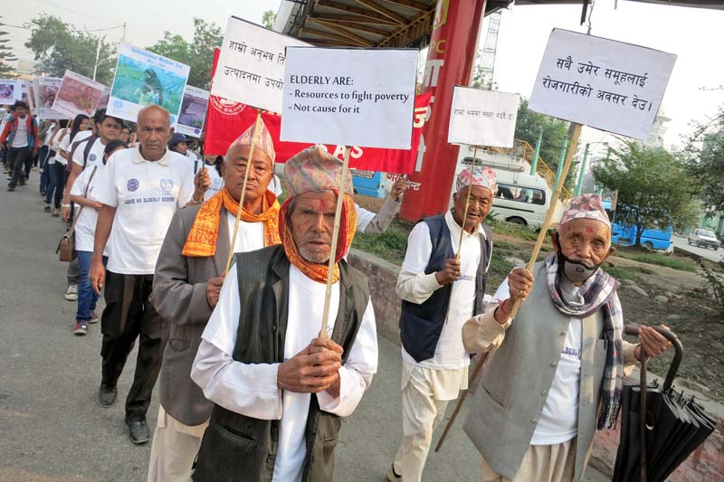 Senior citizens march with placards to demand respect for labour in a rally organised to mark the International Workers Day or May Day, in Kathmandu, on Sunday, May 01, 2016. Photo: RSS