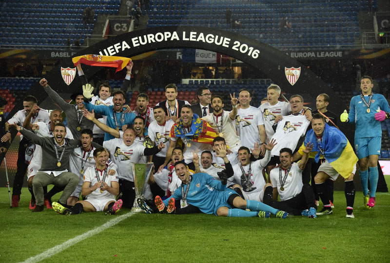 Sevilla's players and officials celebrate with the trophy after winning the UEFA Europa League at the St Jakob-Park Stadium in Basel on Wednesday, May 18, 2016. Sevilla defeated Liverpool 3-1 in final.