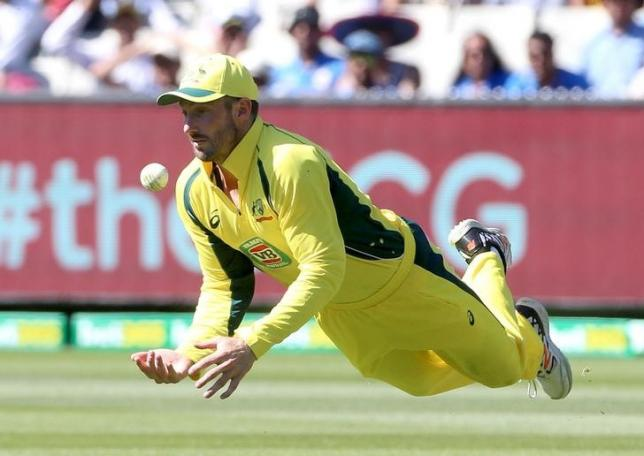 Australia's Shaun Marsh dives to collect a skied shot from India's Virat Kohli on the first bounce during their One Day cricket match at the Melbourne Cricket Ground January 17, 2016. REUTERS/Hamish Blair