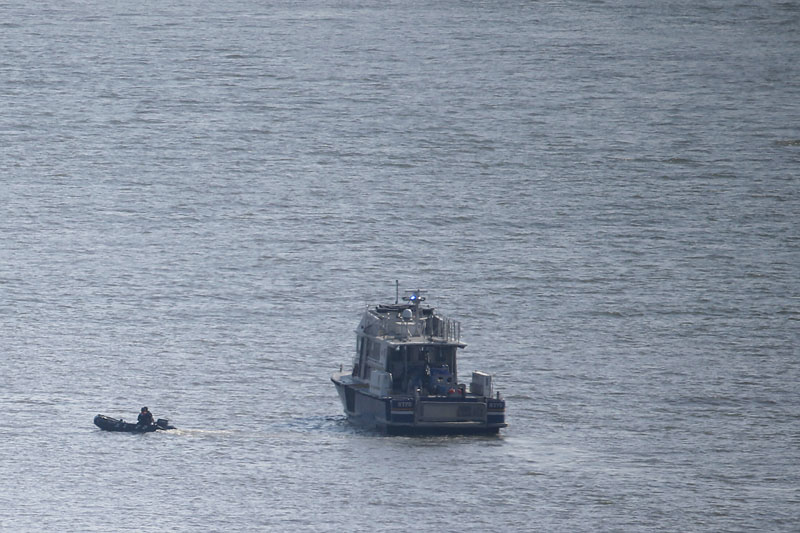NYPD divers ride a boat on the Hudson River near the site of small aeroplane crash, on Saturday, May 28, 2016, in North Bergen, NewJersey. A World War II vintage P-47 Thunderbolt aircraft crashed into the river on Friday, May 27,  killing its pilot. Photo: AP