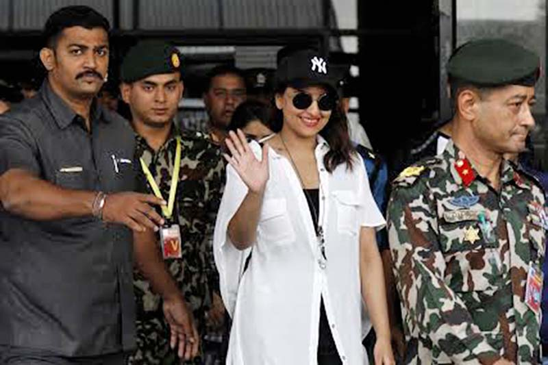 Bollywood actress Sonakshi Sinha waves at her fans after arriving at Tribhuvan International Airport, Kathmandu, on Friday.  She will perform at a concert u2014 Amarpanchhi u2014 in Tundikhel, on Saturday, May 13, 2016. Photo: THT