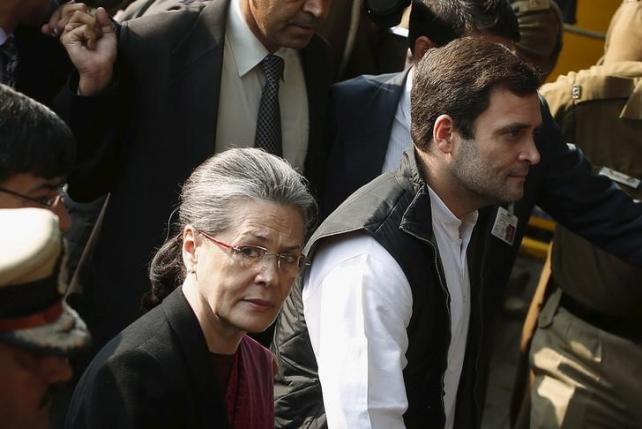 Congress party president Sonia Gandhi (L) and her son and the partyu2019s vice-president Rahul Gandhi, arrive at a court in New Delhi, December 19, 2015. REUTERS/Adnan Abidi/Files