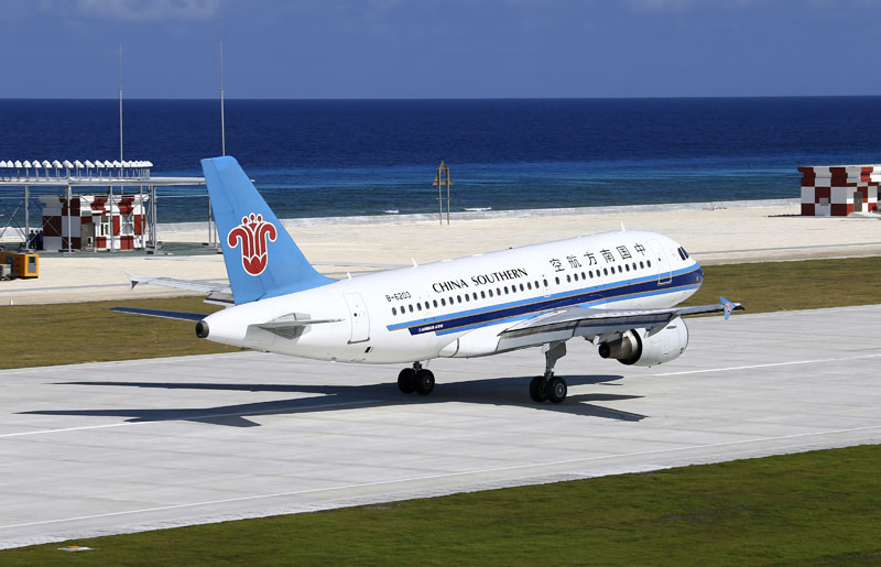 FILE - A China Southern Airlines jetliner lands at the airfield on Fiery Cross Reef, known as Yongshu Reef in Chinese, in the Spratly Islands, known as Nansha Islands in Chinese, of the South China Sea, on January 6, 2016.  Photo: Cha Chunming/Xinhua via AP, File