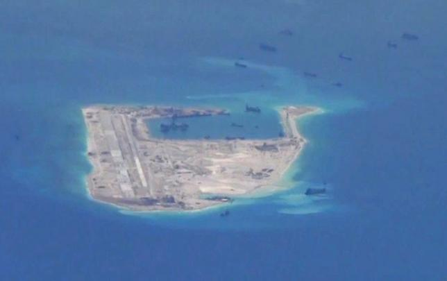 Chinese dredging vessels are purportedly seen in the waters around Fiery Cross Reef in the disputed Spratly Islands in the South China Sea in this still image from video taken by a P-8A Poseidon surveillance aircraft provided by the United States Navy May 21, 2015. U.S. Navy/Handout via Reuters