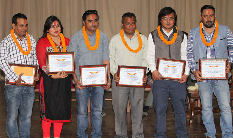 Sports journalists pose for a photo after being felicitated by South Asian Sports Journalistsu2019 Association of Nepal in Kathmandu on Wednesday, May 11, 2016. Photo: Udipt Singh Chhetry/THT