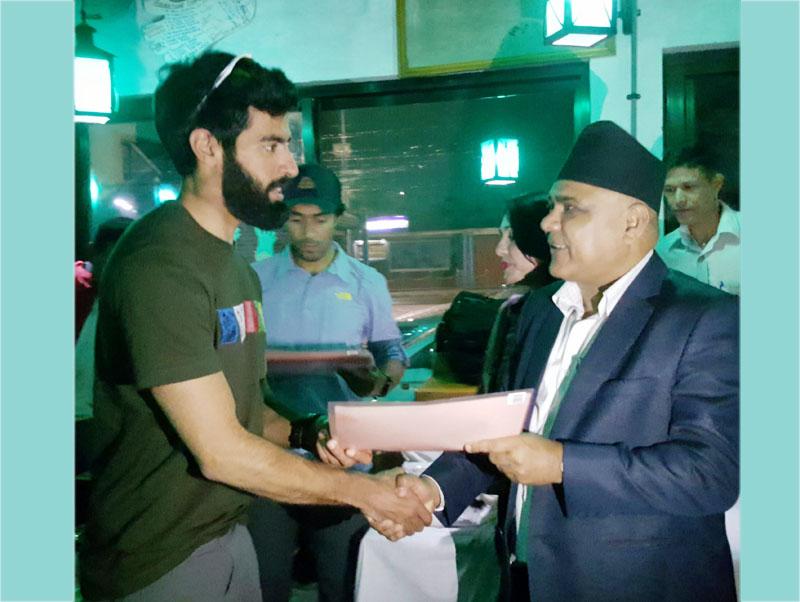 Director General of the Department of Tourism Sudarshan Prasad Dhakal (right) handing over the Mt Everest summit certificate to United Arab Emirates Prince Sheikh Theyab Bin Khalifa Bin Hamdan, in Kathmandu, on Wednesday, May 25, 2016. Photo THT