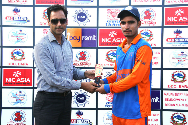 Sunil Dhamala of Kalaiya Cricket Club receiving the man-of-the-match trophy from Vice-president of Bara District Cricket Association Pawan Agrawal (left) in Bara on Wednesday.