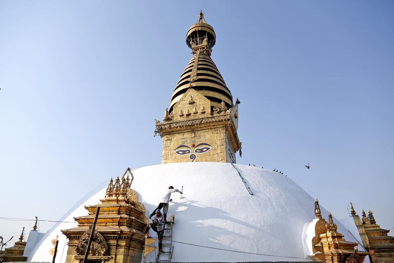 A worker paints the Swayambhunath Stupa, as the Buddist shrine is preparing for the 2560th Buddha Jayanti, in Kathmandu, on Wednesday, May 18, 2016. Photo: RSS