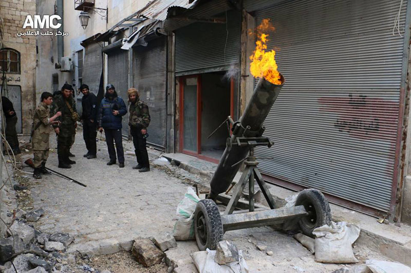 FILE - Syrian rebels firing locally made shells against the Syrian government forces, in Aleppo, Syria, on Sunday February 15, 2015. Photo: AP Photo/Aleppo Media Center, AMC, File