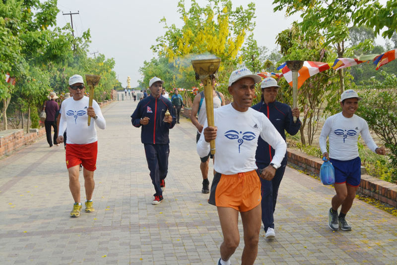 Olympian Baikuntha Manandhar marches on as he holds the Lumbini Peace March and Peace Flame, which is scheduled to reach the Mt Everest Base Camp on May 27, in Lumbini on Sunday.  Photo: THT