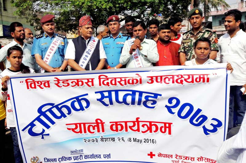 Officials of the District Traffic Police Office, Parsa, and the Nepal Red Cross Society, Parsa chapter, organise a rally to mark the Traffic Week 2073 on the occasion of World Red Cross Day, in Birgunj, on Sunday, May 8, 2016. Photo: Ram Sarraf
