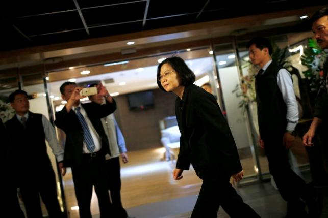 Taiwanese president-elect Tsai Ing-wen walks during a visit to a hospital in Taipei, Taiwan May 17, 2016. REUTERS/Tyrone Siu
