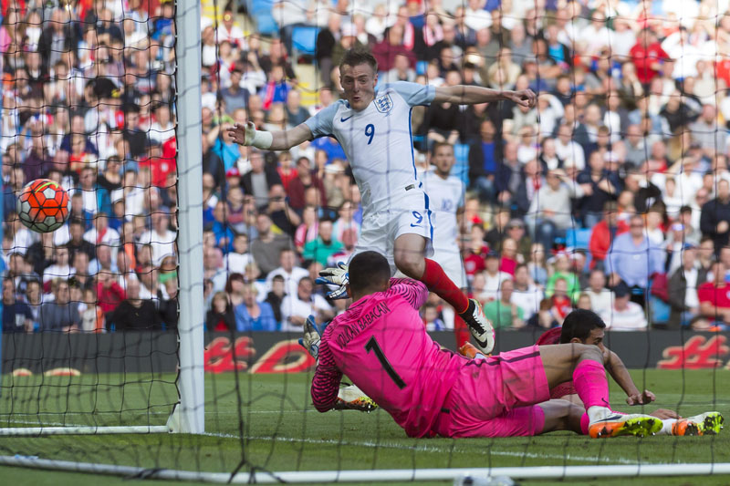 England's Jamie Vardy, top, scores past Turkey's goalkeeper Volkan Babakan during their international friendly football match at the City of Manchester Stadium, Manchester, England, Sunday May 22, 2016. Photo: AP