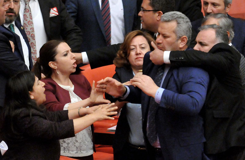 Turkish lawmakers argue and push each other on the assembly floor in Ankara, Turkey, late Wednesday, April 27, 2016.  Turkish lawmakers on Thursday argued and pushed each other as they debated a contentious ruling-party proposals. Photo: AP