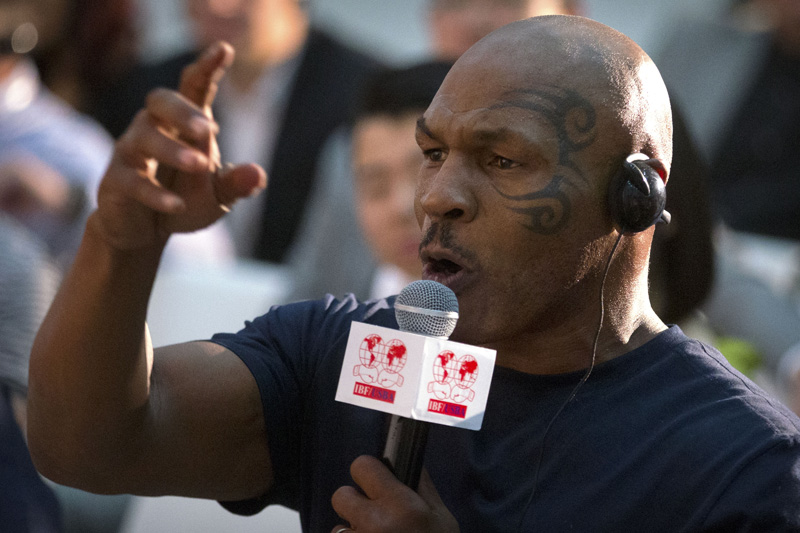 Former heavyweight boxing champion Mike Tyson speaks during a panel discussion held before the 2016 IBF World Championship Bout at the National Tennis Center in Beijing, Wednesday, May 25, 2016. Photo: AP