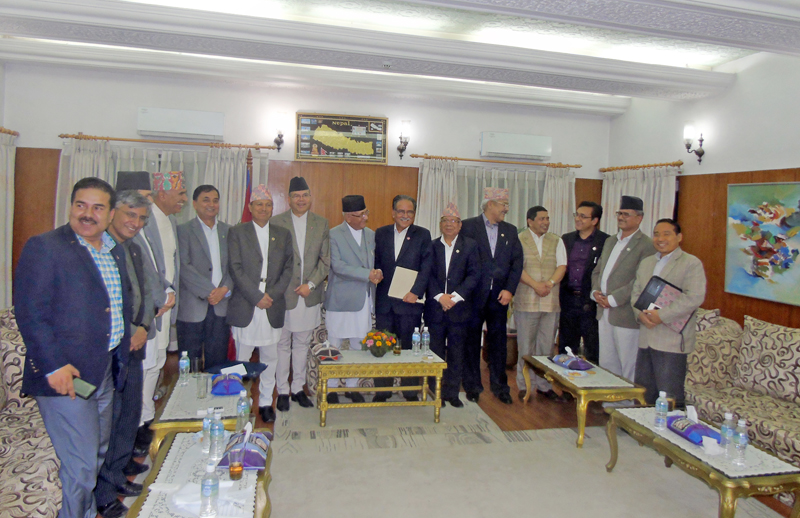 Leaders pose for group photo after signing a nine-point agreement between CPN-UML and UCPN-Maoist, at the PM residence in Baluwatar on Thursday, May 5, 2016. Photo: RSS
