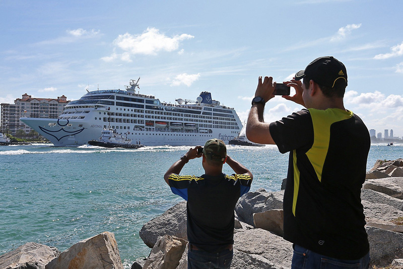 People take photos as Adonia leaves port in Miami, Sunday, May 1, 2016, en route to Cuba. Photo: AP